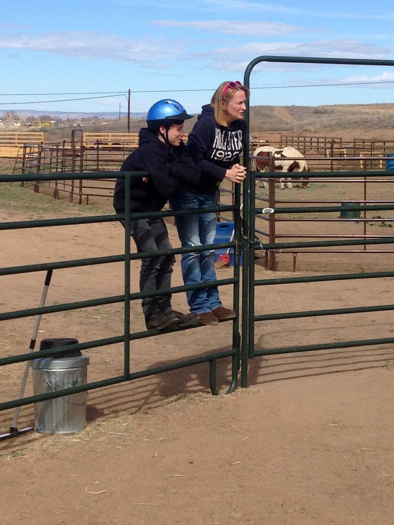 Rider-and-mom-on-fence